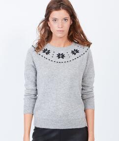 Pull en laine motifs flocons et lien dans le dos gris chine.