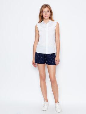 Chemise sans manches à volants blanc.