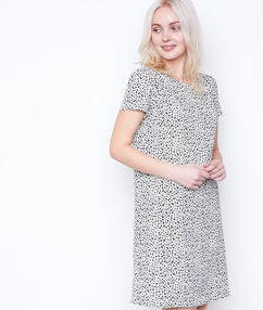 Robe léopard nouée au dos blanc.