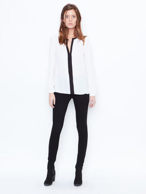 Black and white blouse white.
