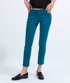 Pantalon slim en coton avec ceinture vert.