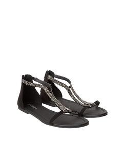 Sandales brillantes en suédine noir.