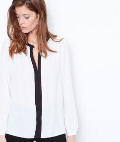 Black and white blouse white.