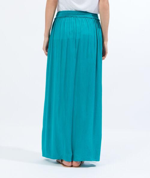 Falda larga de crepón y pompones