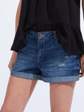 Short en jean déchiré denim brut.