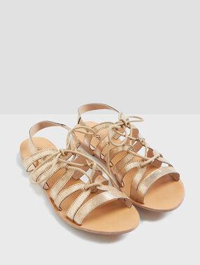 Sandales à lacets dore.
