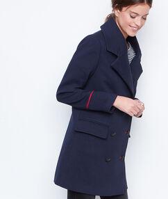 Manteau long officier bleu marine.
