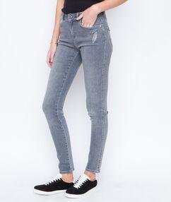 Jeans slim plume brodée gris.