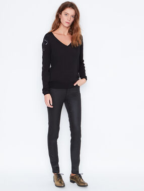 Coated skninny pants with sequin details black.