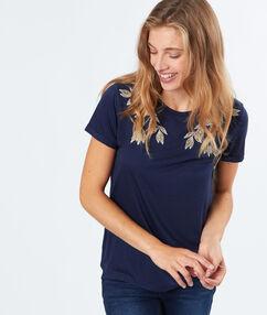 T-shirt feuilles brodées bleu marine.