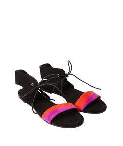 Sandales plates en suédine noir.