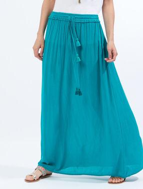 Jupe longue en crêpon à pompons turquoise.