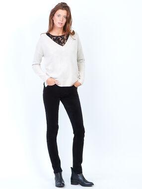 Pantalon slim en velours côtelé noir.