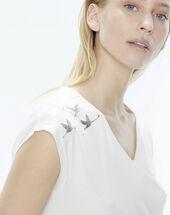 Namingos ecru t-shirt featuring birds on the shoulder silver.