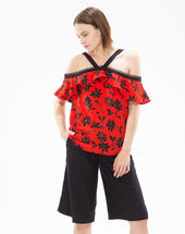 Elixir red top with floral print and an off-the-shoulder cut pumpkin.