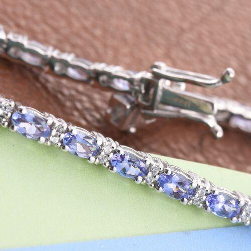 Tanzanite (Ovl), Natural Cambodian Zircon Tennis Bracelet (Size 7.5) in Platinum Overlay Sterling Silver 6.500 Ct.