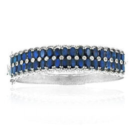 AAA Diffused Blue Sapphire (Ovl), White Topaz Bangle in Rhodium Plated Sterling Silver (Size 7.5) 26.000 Ct.