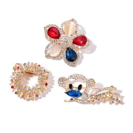 Set of 3 - (Option 2) Simulated White Cats Eye, Simulated Tanzanite, White Austrian Crystal, Multi Colour Crystal and White Glass Floral and Monkey Brooch in Gold Tone 50.000 Ct.