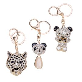 Set of  3 - AAA Black and White Austrian Crystal and Simulated White Cats Eye Enameled Tiger Head, Panda Head and Bear Key Chains in Yellow Gold Tone