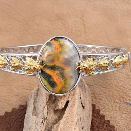 Bumble Bee Jasper (Ovl) Bangle (Size 7.5) in Platinum and Yellow Gold Overlay Sterling Silver 34.000 Ct. Silver Wt 37.00 Gms