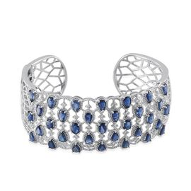 Kanchanaburi Blue Sapphire (Ovl), White Topaz Cuff Bangle in Platinum Overlay Sterling Silver (Size 7.5) 13.000 Ct.