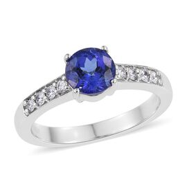 RHAPSODY 950 Platinum 1.50 Carat AAAA Tanzanite Round Solitaire Ring with VS E-F Diamonds.