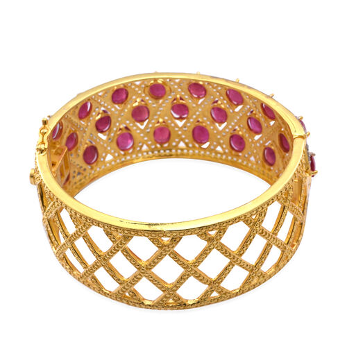 African Ruby (Ovl), White Topaz Bangle (Size 7.5) in 14K Gold Overlay Sterling Silver 50.000 Ct. Silver Weight 51 gms.