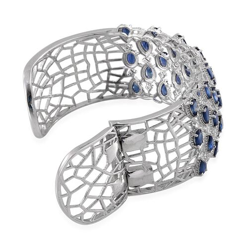 Kanchanaburi Blue Sapphire (Ovl), White Topaz Cuff Bangle (Size 7.5) in Platinum Overlay Sterling Silver 13.000 Ct.