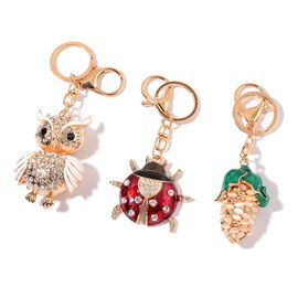 Set of 3 - Simulated White Cats Eye, White and Black Austrian Crystal Owl, Ladybug and Corn Design Key Chains in Yellow Gold Tone