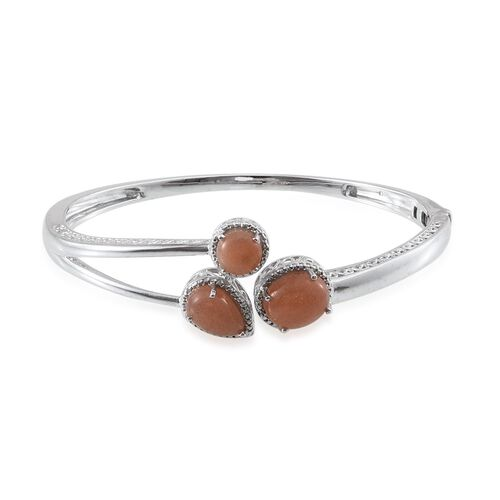 Morogoro Peach Sunstone (Ovl 4.75 Ct), Diamond Bangle (Size 7.5) in Platinum Overlay Sterling Silver 10.020 Ct.