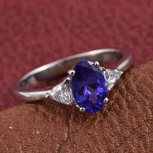 RHAPSODY 950 Platinum 1.25 Carat AAAA Tanzanite Oval Ring, with Trillion Diamonds VS E-F.