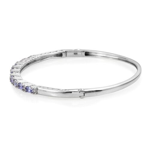 Tanzanite (Ovl), White Topaz Bangle (Size 7.5) in Platinum Overlay Sterling Silver 2.500 Ct.