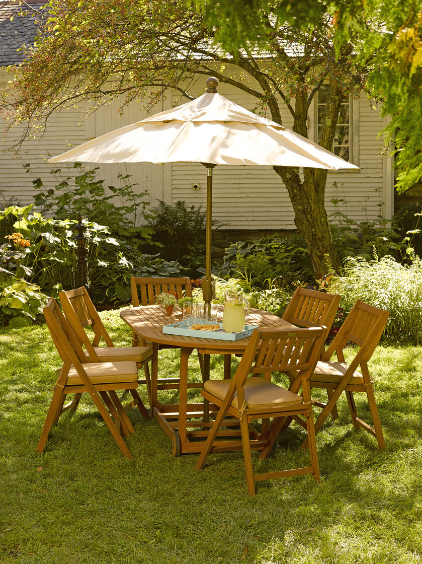 *Umbrella not included. - Patio Table Set: 7-Piece Oval Folding Table Gardeners.com