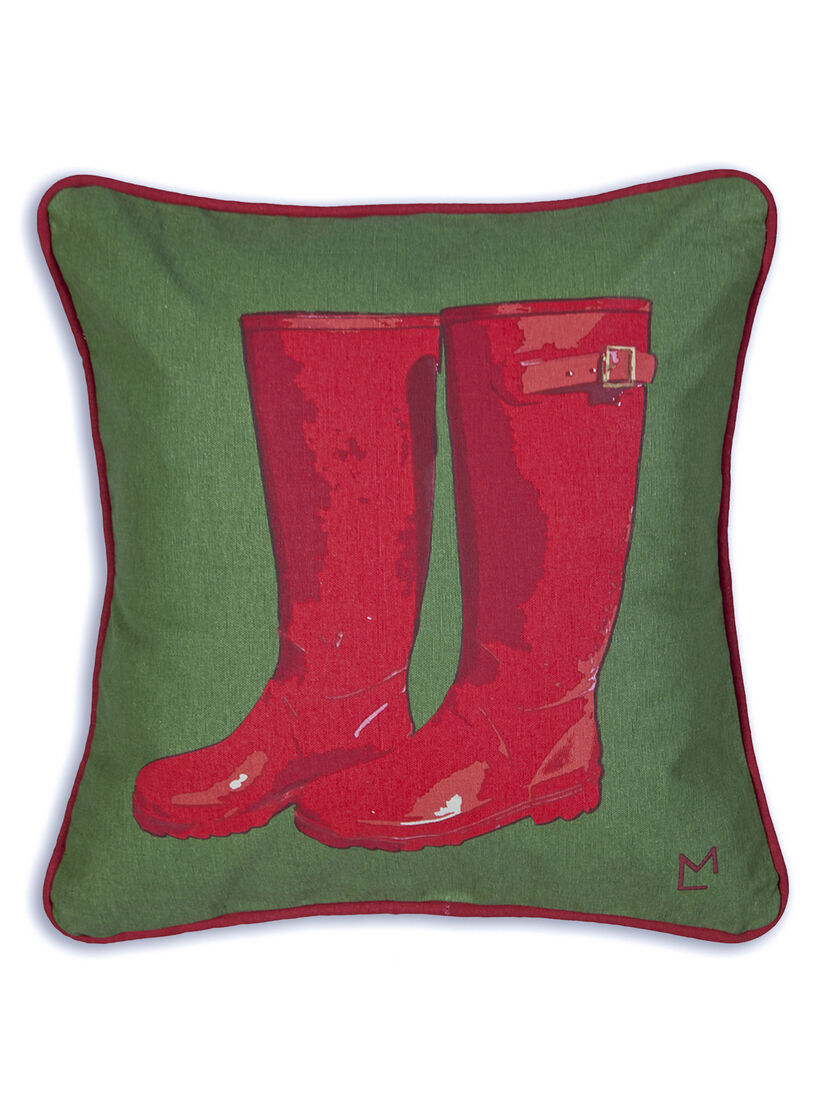 Throw Pillow Red Rubber Boots On Green Sailcloth