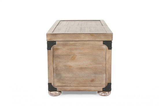 Ashley distressed pine storage cocktail table mathis for Pine coffee table with storage