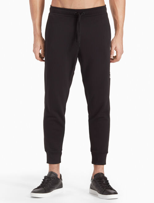 CALVIN KLEIN LOGO TERRY TAPERED SWEATPANTS