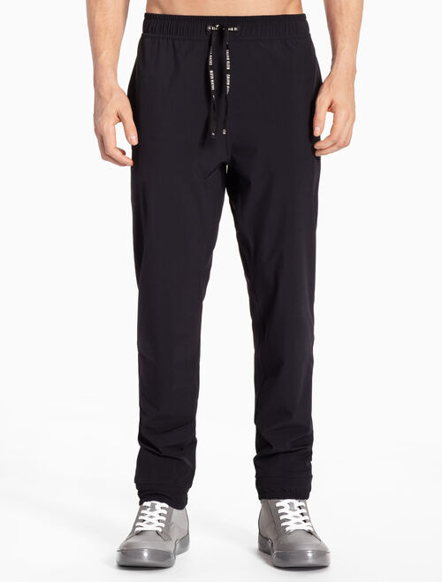 CALVIN KLEIN WOVEN TAPERED SWEATPANTS WITH LOGO DRAWSTRING