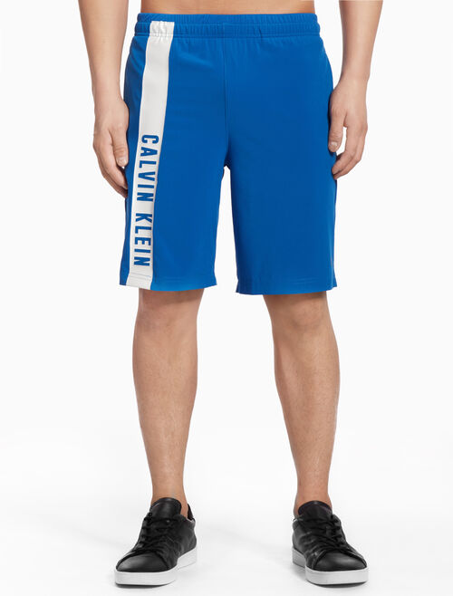 CALVIN KLEIN SHORTS WITH SIDE LOGO STRIPES