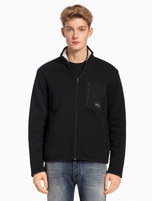 CALVIN KLEIN REVERSIBLE INSTITUTIONAL ZIP UP JACKET