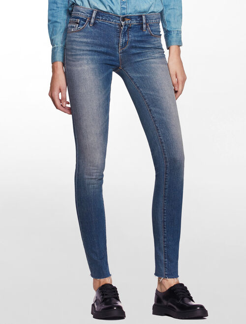CALVIN KLEIN PERIWINKLE MID RISE SKINNY JEANS