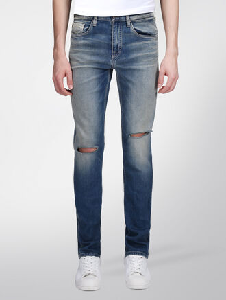 CALVIN KLEIN SUN STAINED BODY JEANS