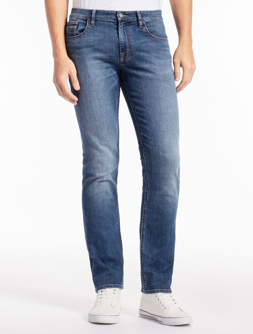 CALVIN KLEIN AIRY MID WASH SKINNY JEANS