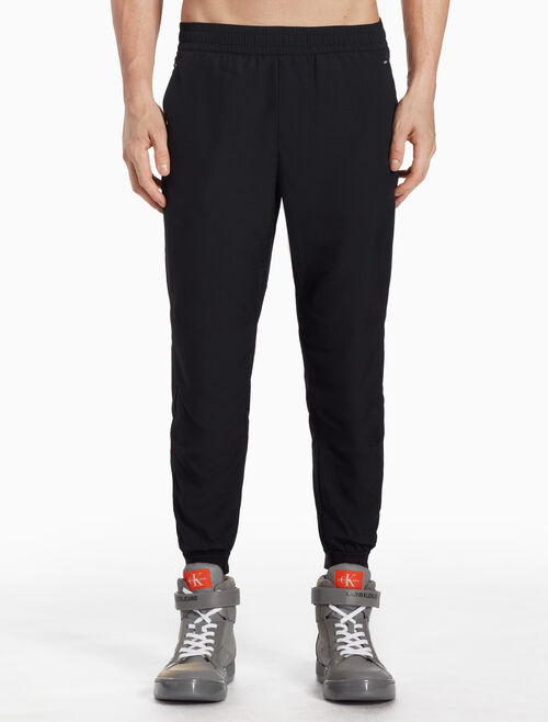 CALVIN KLEIN WOVEN TRACK PANTS WITH LOGO BADGE