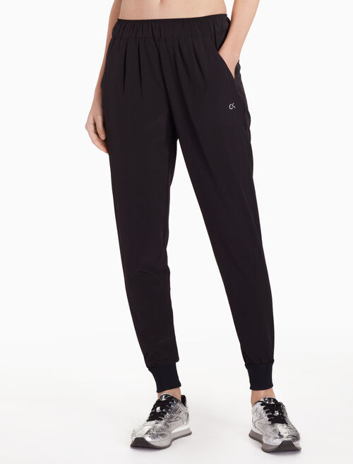 CALVIN KLEIN WOVEN SWEATPANTS WITH SIDE STRIPES