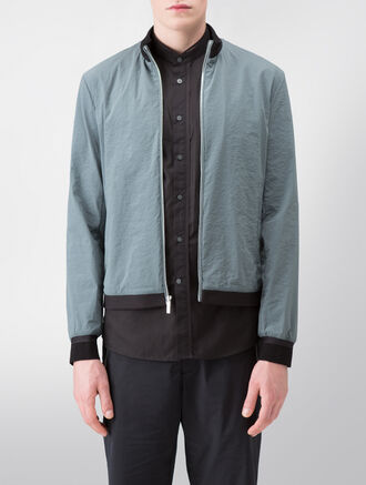 CALVIN KLEIN TRANSLUCENT STRETCH NYLON OUTERWEAR WITH MESH TRIM( WES FIT )
