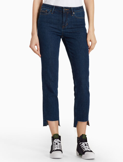 CALVIN KLEIN INDIGO SKINNY JEANS WITH AYSMMETRIC FRAYED LEGS