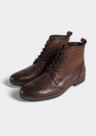 Hoge laarzen met veters en gebloemde top