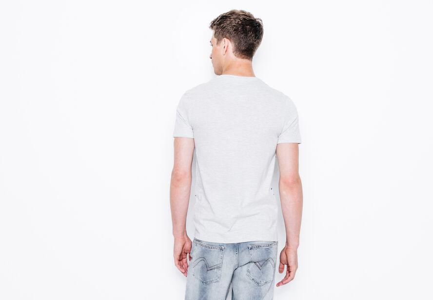 T-shirt col rond rayé avec poche florale