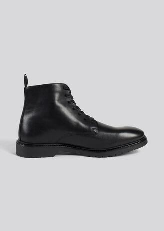 Boots montantes cuir lisse et semelle épaisse