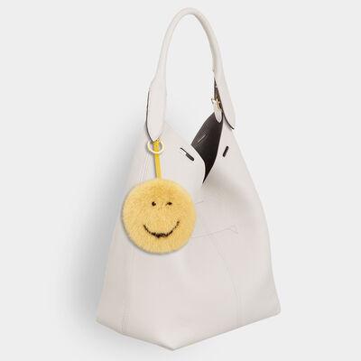 Smiley Mink Tassel by Anya Hindmarch